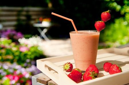 Fresh tasty strawberry smoothie in the summer garden photo