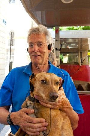 Dog is making a trip with his boss in an excursion train listening to the tourist information photo