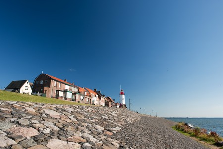 White lighthouse in little Dutch fishing village Urk Stock Photo - 7541669