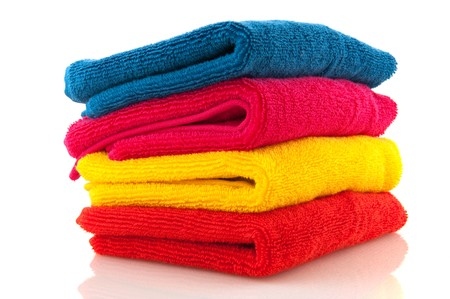 Pile colorful towels in orange yellow pink and blue photo