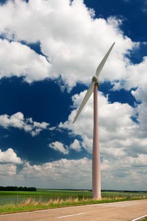 Wind turbine in Dutch agriculture landscape in summer photo