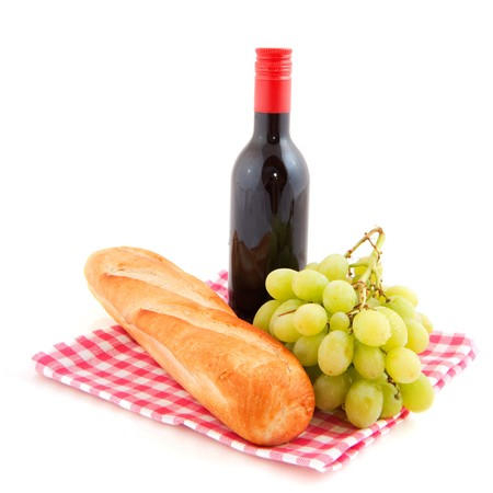 Red wine, French bread and white grapes for the picnic photo