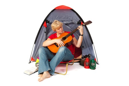 campground: elderly woman with guitar at the campground