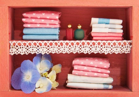 linen closet with bottles and flowers in miniature photo