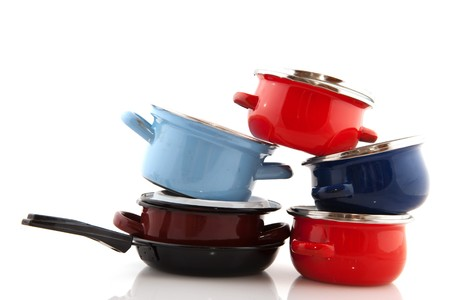 pots pans: Big stack with pots and pans isolated over white