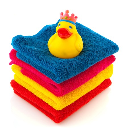 stack with colorful folded towels and a bath duck photo