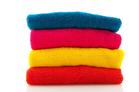 towel: stack with colorful folded towels isolated over white Stock Photo