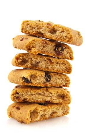 chuncks of fresh cookies with raisins isolated over white photo