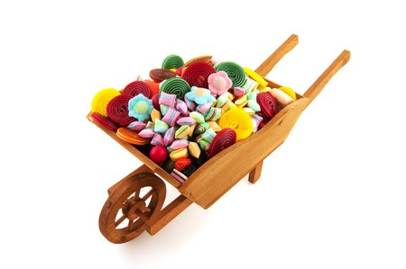 Wheel barrow full with lots of sweet candy Stock Photo