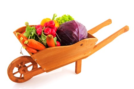 Wooden crate with a diversity of fresh vegetables photo