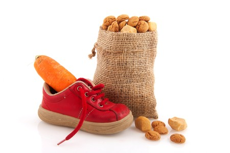 Shoe with carrot for horse of Sinterklaas and pepernoten isolated over white Stock Photo - 7828552