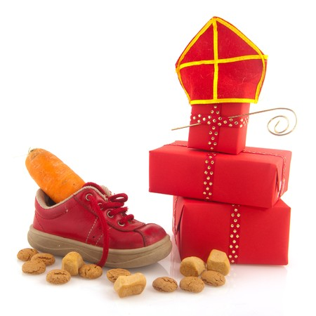 pepernoten: Shoe with carrot for horse of Sinterklaas and pepernoten isolated over white Stock Photo