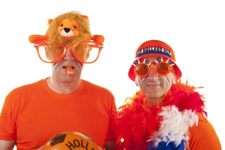 Dutch soccer supporters in orange on white background photo