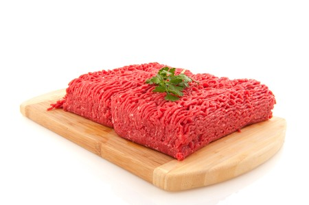 minced meat: Minced meat with parsley isolated over white