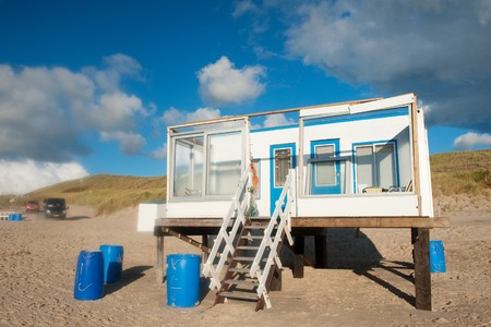 Simple beach house in blue and white at the Dutch coast photo