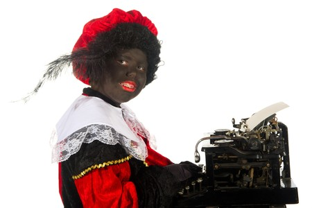 Black Piet is writing a poem in the studio Stock Photo - 7828820