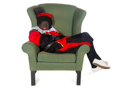 Black Piet lazy laying in chair in the studio Stock Photo - 7828828