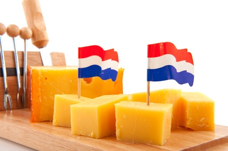 Pieces of Dutch cheese on timber board Stock Photo