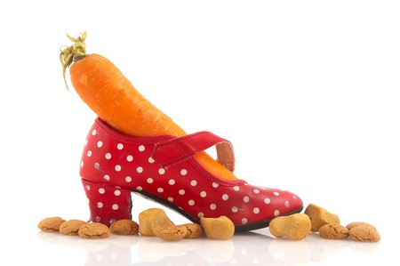 sinterklaas: Red dotted shoe with carrot for the horse of Sinterklaas