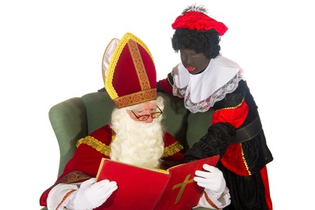 Dutch culture with Sinterklaas and Black Piet and the big red book Stock Photo - 7828838