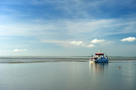 wadden: Ferry boat at wadden sea during ebb tidal
