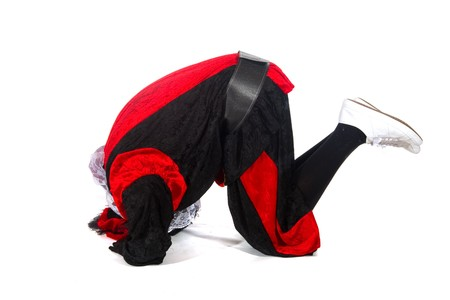 Black Piet is rolling at the floor on white background Stock Photo - 7908195