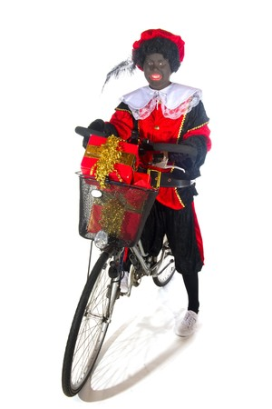 Black Piet with a bike and preents Stock Photo - 7908198