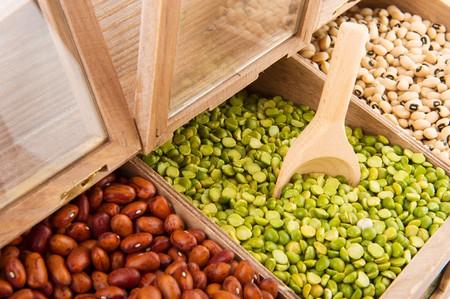 shelfs: Various dried legumes in wooden shop shelfs