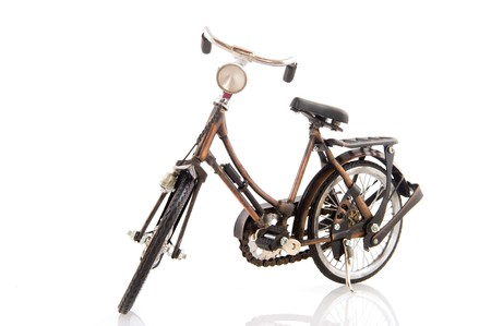 Old female bike standing isolated over white photo