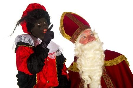 Sinterklaas and Black Piet pointing upwards in the studio Stock Photo - 7908202