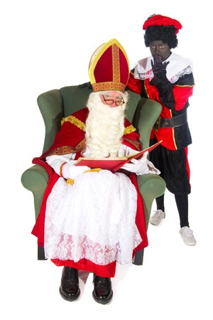 Sinterklaas and Black Piet reading in the red book Stock Photo - 7908206