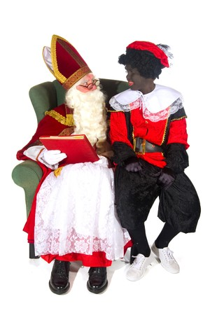 Sinterklaas and Black Piet and the red book Stock Photo - 7908201