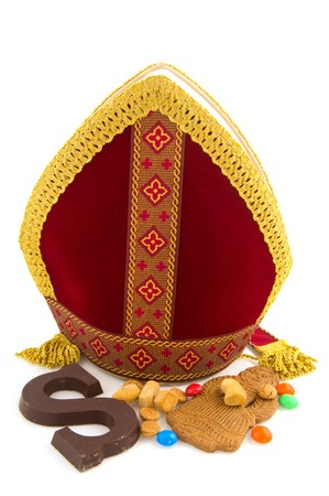 Miter from Sinterklaas with traditional candy isolated on white background photo