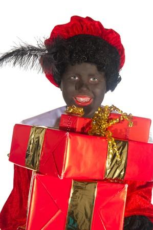 Black Piet is having lots of traditional Sinterklaas gifts Stock Photo - 7908218
