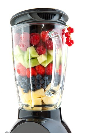 Various healthy fresh fruit in the blender Stock Photo