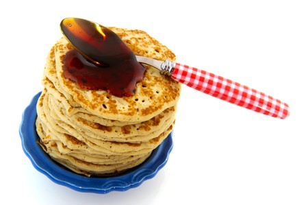 Big stack fresh pancakes with spoon of sirop Stock Photo - 7933605