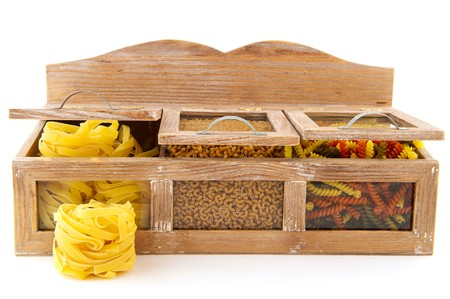 pasta assortment in old wooden cupboard isolated over white photo