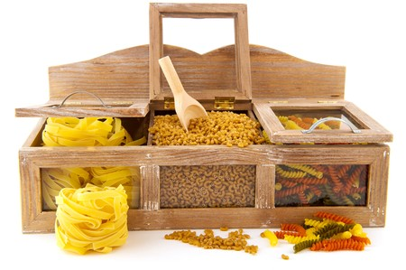 pasta assortment in old wooden shop shelf isolated over white photo