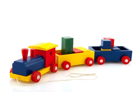 Wooden toy train with colorful blocks locomotive and wagons photo