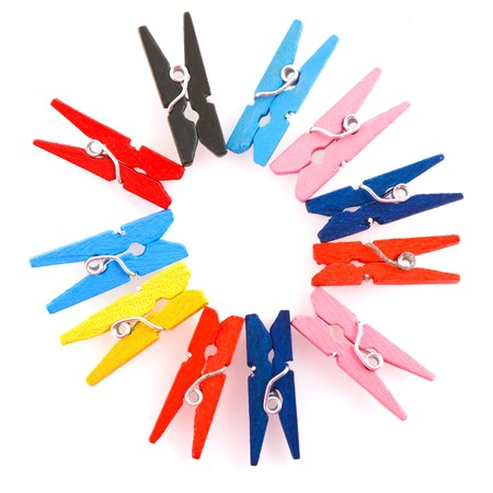 pegs: colorful clothes pins in circle pattern isolated over white