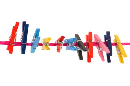 colorful clothes pins for hanging the laundry photo