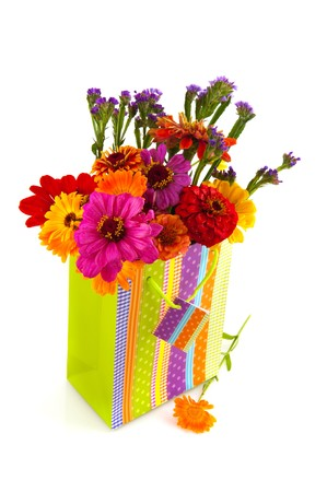 colorful flower bouquet in paper gift bag photo
