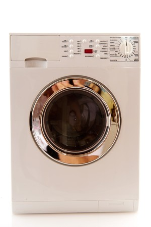 Laundry machine for washing textile and laundry isolated over white photo