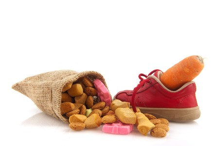 Shoe with carrot for horse of Sinterklaas and pepernoten isolated over white Stock Photo - 8056176