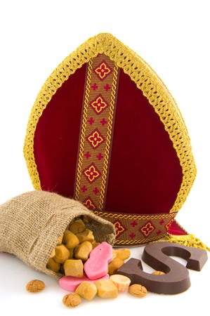 Miter from Dutch Sinterklaas with traditional candy photo