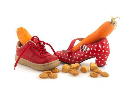 Shoes with carrots for horse of Sinterklaas and pepernoten isolated over white Stock Photo - 8056177