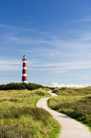 classic lighthouse in red and white at Dutch island Ameland