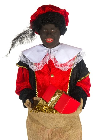 Dutch Black Piet with jute bag full of presents photo