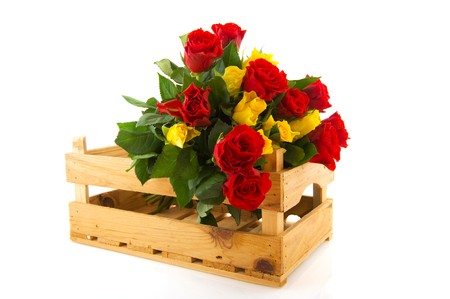 Bouquet red and yellow roses in wooden crate photo