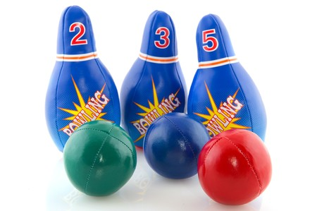 Bowling game with several pins and colorful balls Stock Photo - 8056386